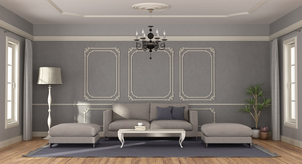 3D rendering of a gray sofa and footstool in a room