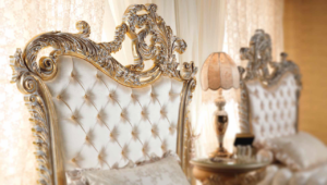 Close up of the gold engraving on a bed by Aida Collection